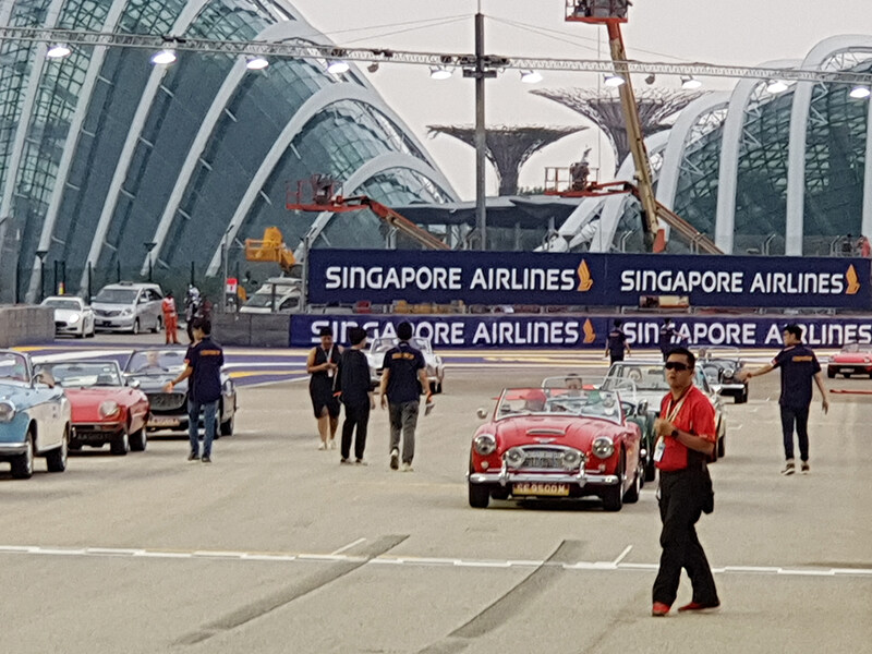 Different vintage sports cars line up on the track