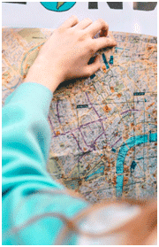 Girl's hand holding the map
