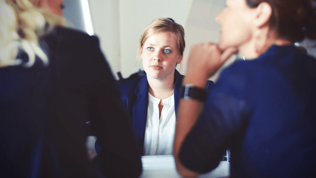 Applicant in the middle of an interview with a panel of interviewers