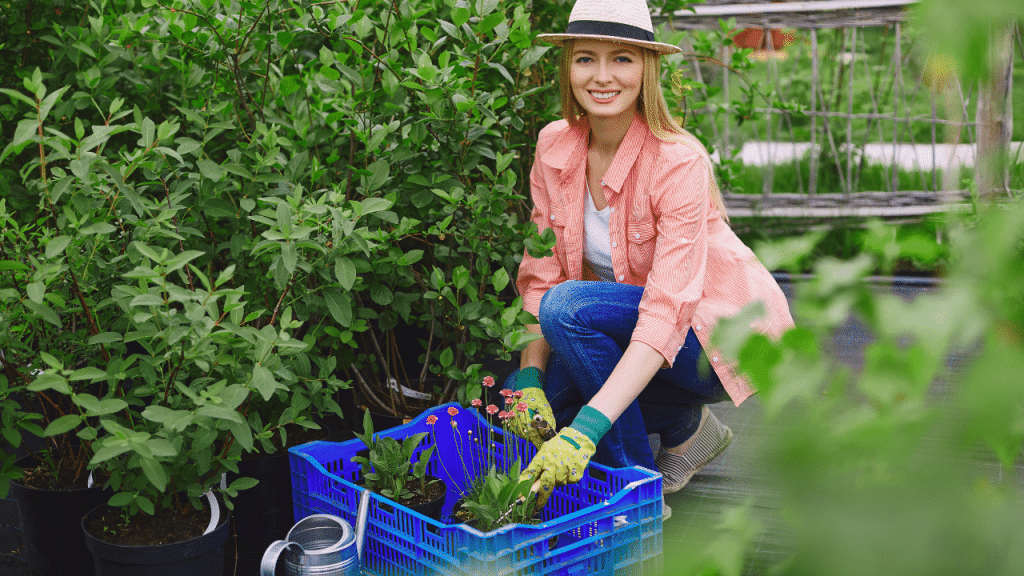 Young lady who finds happiness in gardening is loving what she does