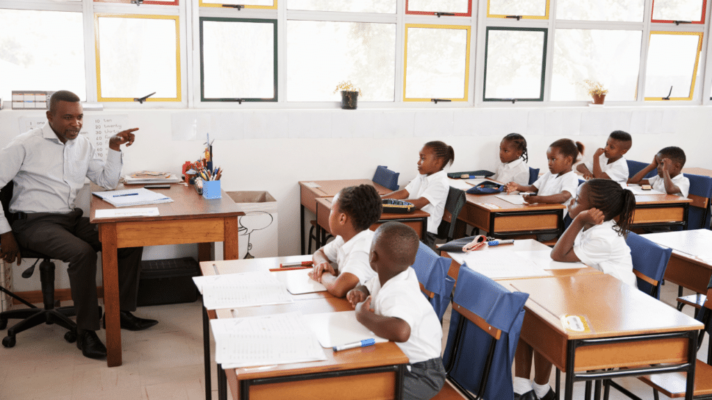 A teacher teaches kids in the class on whatever curriculum the school has given him