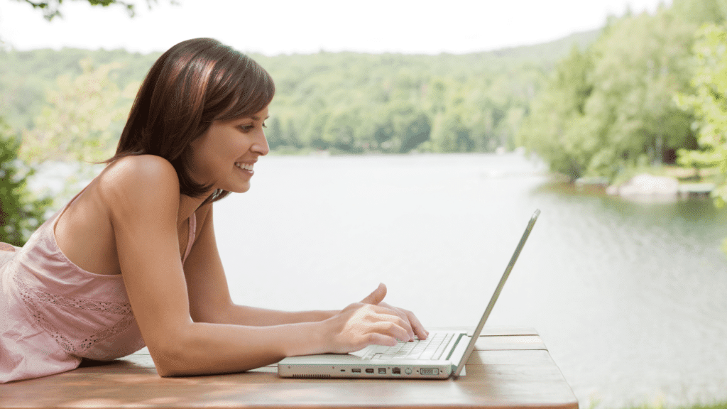 Woman working remotely while enjoying her time